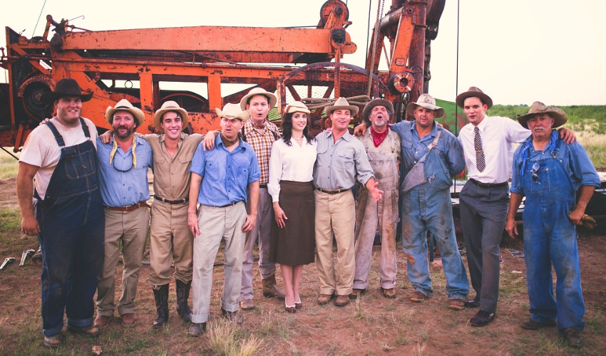 The film's stars, Ali Cobrin and Lane Garrison (both at center), are flanked by other players during a break in action on The Iron Orchard. Austin Nichols is second from left. A period-authentic portable drilling unit is their backdrop.