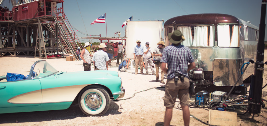 Visible center/background in this photo of the film crew is director Ty Roberts and assistant director George Sledge, both facing the camera.